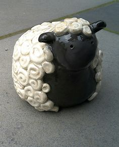 Barbara the 🐏 Ceramic Sheep, with a very woolly fleece. A ceramic garden ornament (14 cm high) a hand built pinch pot using a coiling technique. This cute ceramic lamb is very tactile too.