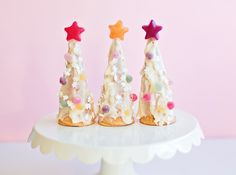 Festive Frosted Ice Cream Cone Christmas Tree   If you're looking for a fun and easy holiday treat to make with the kids, look no further than these cute ice cream cone trees.