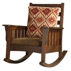 "Solid hardwood rocking chair in dark oak with chocolate microfiber upholstery.     Product: Rocking chair and pillow    Construction Material: Wood frame and microfiber upholstery   Color: Chocolate and dark oak    Dimensions: 41"" H x 33"" W x 41.75"" D"