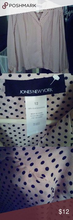 Pink and black polka dot silk blouse. Like new Jones of New York blouse with no stains or damage. The only flaw is shown on pic three. That is not a hole but the sewing is unraveling in that area of blouse. Blouse has been well taken care of and has been dry cleaned as well. Price is set due to wear that you see in pic three. Jones New York Tops Blouses
