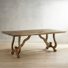 Handcrafted of solid mango wood, our Juniper Dining Table is the ideal combination of rustic beauty and utility. The elegant scroll base is a graceful and unique twist on the traditional trestle dining table. Comfortably seating 6-8, the craftsmanship and hand-applied finish make each table one of a kind.