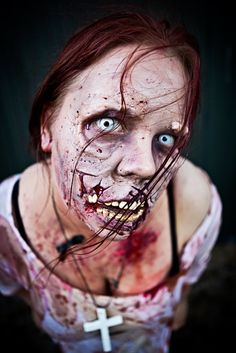 Gruesome zombie lady with mangled face & teeth / Paired with all white zombie contact lenses =>  http://www.pinterest.com/pin/350717889705763104/