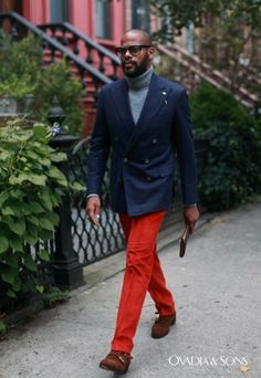 Tap into refined, elegant style with a navy double breasted blazer and red trousers. If you don't want to go all out formal, grab a pair of brown suede double monks.  Shop this look for $368:  http://lookastic.com/men/looks/grey-turtleneck-navy-double-breasted-blazer-red-dress-pants-brown-double-monks/4313  — Grey Turtleneck  — Navy Double Breasted Blazer  — Red Dress Pants  — Brown Suede Double Monks