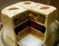 """This must be what they serve in Heaven!  Cherpumple.      It's a cherry pie, a pumpkin pie, and an apple pie, each baked within different kinds of cake."""""""