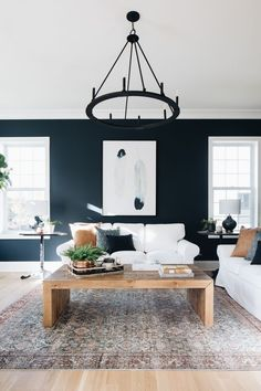 family room featuring wooden coffee table, white couch, and a round black metal candle chandelier. Family Room Decorating, Decorating Your Home, Diy Home Decor, Family Room Colors, Family Rooms, Country Wall Mirrors, Family Room Lighting, Oak Floating Shelves, Living Room Modern