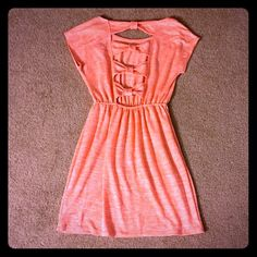 NWT cute cream sickle orange dress with bows This is such a cute dress! Creamsickle orange color with heather look. Decorative bows on the back. Cinched elastic waist. New with tags. Aqua Dresses Mini