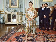 Crown Princess Victoria of Sweden dazzled in a swan print dress as she welcomed Finland's president to the Royal Castle, Stockholm