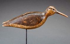 Running Curlew by Nathan F. CobB Jr. (1825-1905) Cobb Island, VA, c. 1880. This bold decoy features a classic Cobb tail split, an original oak bill and black glass eyes within carved eye grooves. While Cobb curlew decoys are rare, this bird with its original paint and bill is a particularly noteworthy example.