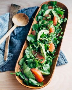 A vibrant vegan and Whole 30-friendly ruby-red grapefruit and avocado salad with watercress, parsley, and a creamy pepita green goddess dressing.