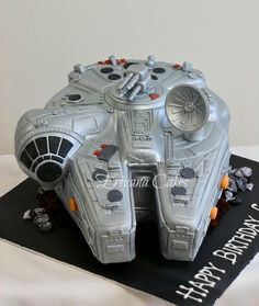 "Millenium Falcon cake that I made for a client. Carved out of 10"" round slab cake and a 6"" square cake."