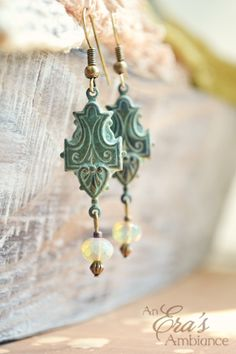 """The """"Water Crest"""" Earrings are a romantic Renaissance design with a patina finish."""
