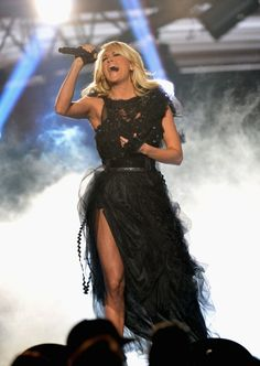 """Carrie performs """"Two Black Cadillacs"""" at the 2012 American Music Awards."""