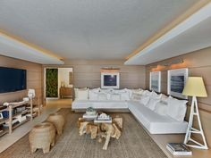 Above a sofa hangs a custom rope artwork. Photography by Eric Laignel.