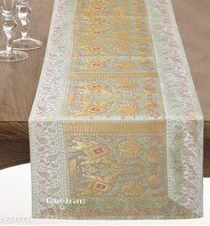 Table Runner Colorful Brocade & Poly Satin Table Runners Fabric: Poly Satin Size: Dimension (L X B) - 60 in X 16 in Description: It Has 1 Piece of Table Runner Work: Brocade Patch Work Sizes Available: Free Size *Proof of Safe Delivery! Click to know on Safety Standards of Delivery Partners- https://ltl.sh/y_nZrAV3  Catalog Rating: ★4.5 (260)  Catalog Name: Elegant Designer Poly Satin Table Runners Vol 2 CatalogID_92922 C129-SC1127 Code: 534-808561-