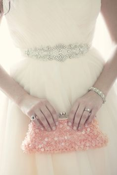 Bridal Accessories with Beaded Sash, Jewelry, and Pink Sequined Clutch | Orchestrated Grace https://www.theknot.com/marketplace/orchestrated-grace-traverse-city-mi-366604 | Kristen Taylor & Co https://www.theknot.com/marketplace/kristen-taylor-and-co-birmingham-mi-223890 |