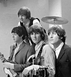 Do you think Ringo knew that it looked like John was sporting a brass thingy on top of his head? Lol.