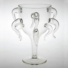 A set of seven wine glasses inspired by the seven deadly sins: lust, gluttony, greed, sloth, wrath, envy and pride