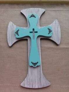 Bottom cross is spray paint that was wiped while still wet. The top cross is diy chalk paint with embellishments