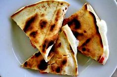 Classic Mexican and Tex Mex cheese quesadilla recipe.  Toasted flour tortilla with melted cheese inside.