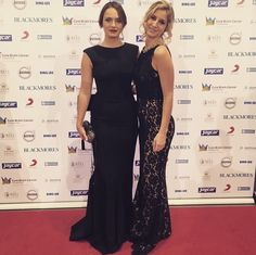 Chloe Morello on the red carpet wearing AW15 Elle gown in Black and friend wearing Lainey Gown in Black