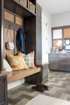 mudroom inspiration - herringbone floors, built-in bench, storage, boho styling