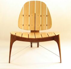 Custom patio chairs made of walnut, northern white cedar and stainless steel. Two chairs for $1,900.