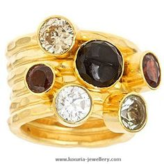 The SIENNA ring is 6 delicately hammered  rings bonded together to make one stunning piece.It will take you from day to night in the blink of an eye. www.luxuria-jewellery.com #stacking rings #gemstone rings