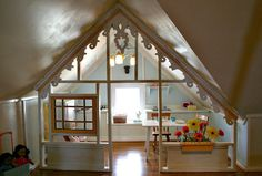 "This enchanted attic nursery and playroom was built using repurposed treasures for a delightful result! Lynn, the mother responsible for this cozy, warm space, says, ""The attic is pure childhood. There is a playhouse for pretending, a reading nook, and the trees and clouds are so that Addison can have a sense of being outside ...continue reading"