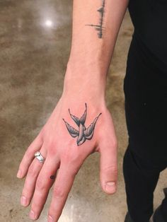 2 new tats. A bird and an infinity sign on his middle finger.