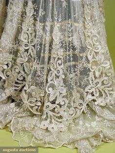 TRAINED NET LACE TEA GOWN, c. 1910 U-neckline, short sleeve, dotted cotton net w/ allover floral lace in garlands, trimmed w/ inserts of Battenburg, flounced net & lace underskirt, long train. Detaile back.
