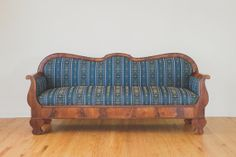 An antique sofa comes to life with new upholstery.