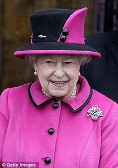 Royal hat - ensemble worn in Leicester for the diamond jubilee festivities: The Queen is in fuchsia and black wool felt with button trim.