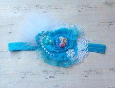 He encontrado este interesante anuncio de Etsy en https://www.etsy.com/es/listing/194709166/frozen-elsa-ice-queen-boutique-headband