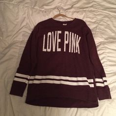 Victoria's Secret love pink sweatshirt Size small Victoria's Secret crew sweatshirt with their slogan love pink on the front. The crew is dark purple with white lettering and white horizontal stripes across the bottom. PINK Victoria's Secret Sweaters Crew & Scoop Necks