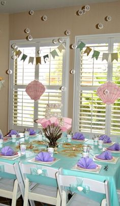 Beautifully decorated table at a Mermaid girl birthday party!  See more party ideas at CatchMyParty.com!