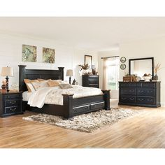With the rustic beauty of the painted black finish, accented with rub-through aged brown that matches the finish of the contrasting tops, along with the large scale architectural look, the Breen Bedroom Set by Signature Design by Ashley Furniture flawlessly captures the true atmosphere of vintage styled furniture to create the bedroom you have been dreaming about. $1,610