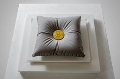 ONE BITCOIN Concrete Pillow holding the weight of a Bitcoin. Sculpture enclosed in a glass urn. Concept: The sculpture is an ode to the blockchain revolution, headed by Bitcoin. An altar to innovation and to the new digital assets that no government or #gold