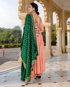 Peach Mughal Handblock Suit Set – Aachho Peach Mughal Handblock Suit Set embellished with beautiful Gota detailing. The set comes with a beautiful bottle green Handblock dupatta. Stylish Dress Designs, Designs For Dresses, Stylish Dresses, Half Saree Designs, Kurta Designs, Blouse Designs, Indian Bridal Outfits, Indian Designer Outfits, Punjabi Suits Designer Boutique