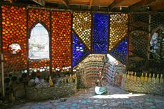 """Bottles upcycled into a village - Beginning construction in 1956 at age 60, and working until 1981, Tressa """"Grandma"""" Prisbrey transformed her 1/3 acre lot into Bottle Village, an otherworld of shrines, wishing wells, walkways, random constructions, plus 15 life size structures all made from found objects placed in mortar."""