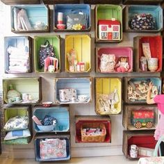 Great use of old crates painted and nailed to the wall. A tidy mess :-)