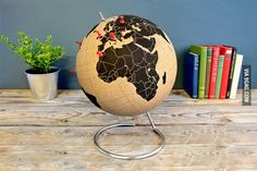 A Globe made of cork so you can mark the places you've been. I need this!! And a whole bunch of money so I can travel around the world!! :D