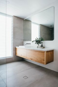Bathroom: A marble bench top is complete with two separate vanity sinks and faucets, a giant mirror and large baths and shower Ensuite Bathrooms, Laundry In Bathroom, Bathroom Renos, Bathroom Inspo, Bathroom Inspiration, Small Bathroom, Modern Bathroom, Minimalist Bathroom Design, Bathroom Interior Design
