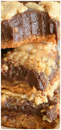 Peanut Butter Fudge Cookie Bars ~ The most decadent layer of fudge nestled between two layers of irresistible peanut butter cookies!
