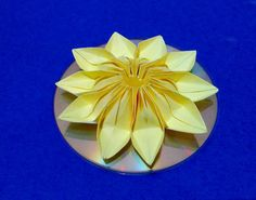 Easy Christmas ornament flower + CD. Origami Christmas ornament