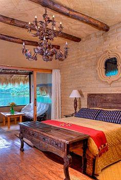 Laguna Lodge Eco-Resort & Nature Reserve in Guatemala. The pictured Quetzal Suite has views of Lake Atitlan and volcanoes.