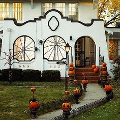 Pumpkins Along Fence on Posts - Inspire Bohemia: Halloween Decor for the Outdoors