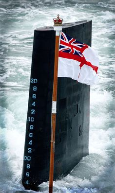 SURFACING. ROYAL NAVY SUBMARINE AND RED ENSIGN. THE HOKEY POKEY MAN AND AN INSANE HAWKER OF FISH BY CONNIE DURAND. AVAILABLE ON AMAZON KINDLE.