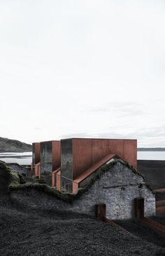 SAMI Arquitectos has slotted a modern concrete house behind the crumbling stone walls of a ruined building, located on an island in the Northern Atlantic Architecture Old, Contemporary Architecture, Contemporary Landscape, Sustainable Architecture, Beton Design, Adaptive Reuse, Contemporary Decor, Contemporary Stairs, Contemporary Building