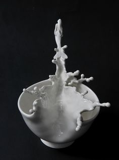 ceramic sculptures Johnson Tsang This piece displays movement. The illusion of splashing liquid moving out in all directions makes it look like it is in motion.