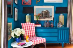 Bright hues and a clever layout transform a small bedroom into a larger-than-life spot to kick back and relax.